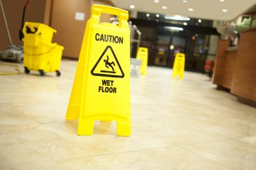 "yellow ""wet floor"" sign in lobby, personal injury"