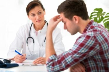 doctor taking notes with a patient, personal injury