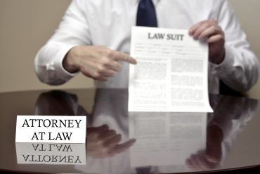 attorney pointing to a law suit paper