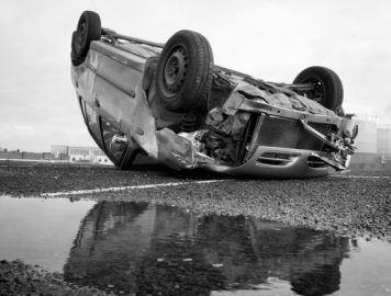black and white image of rollover vehicle, car accident