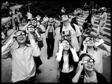 people wearing eclipse sunglasses