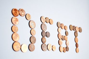 coins spell a debt word, debt lawyer