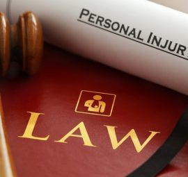 a gavel with a law book, personal injury