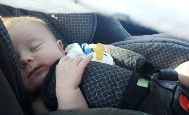 baby sleeping in a car seat, injury lawyer