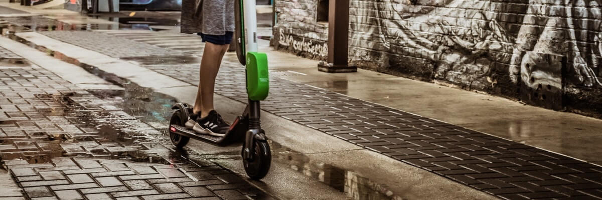 kid using rental scooter