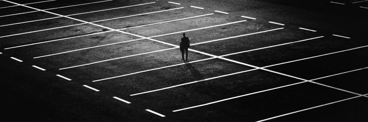man in the middle of a parking lot