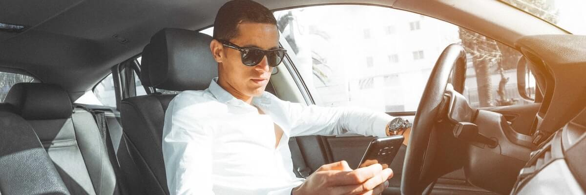 distracted driver on his phone