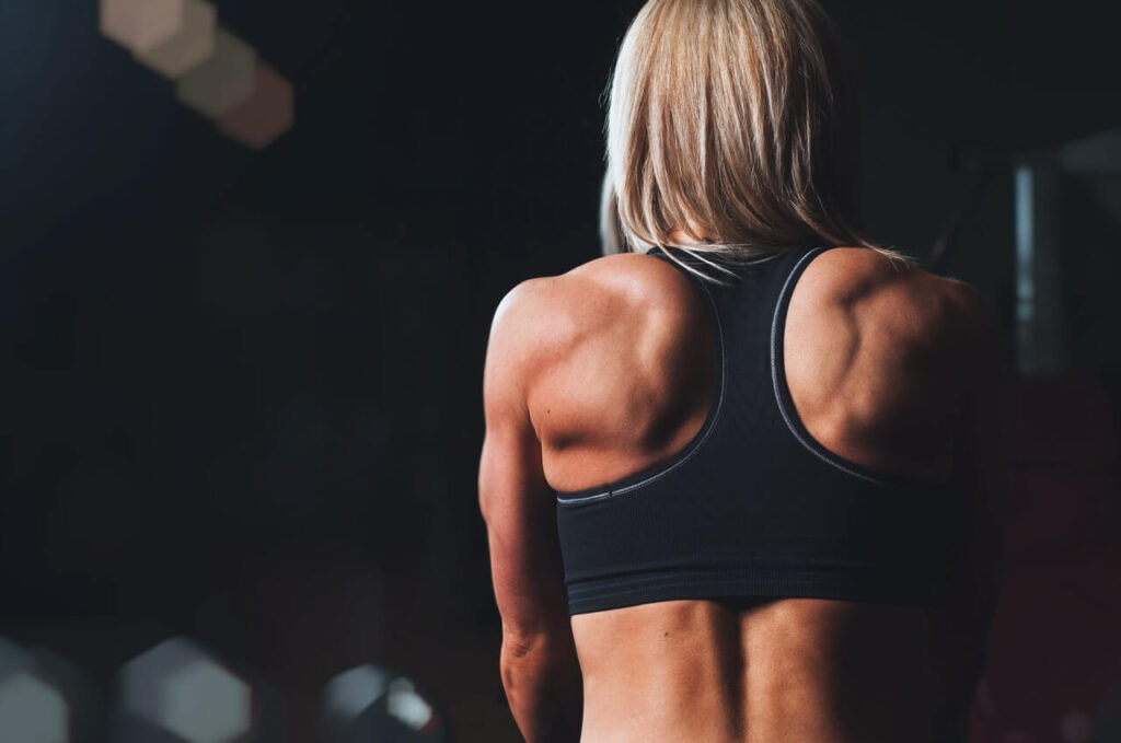 back of woman showing shoulders and back working out