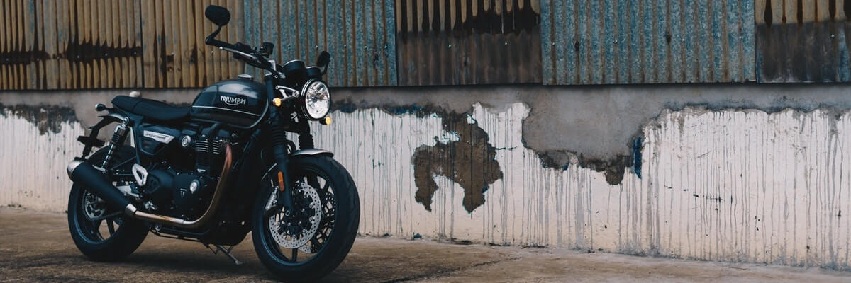 motorcycle against a wall